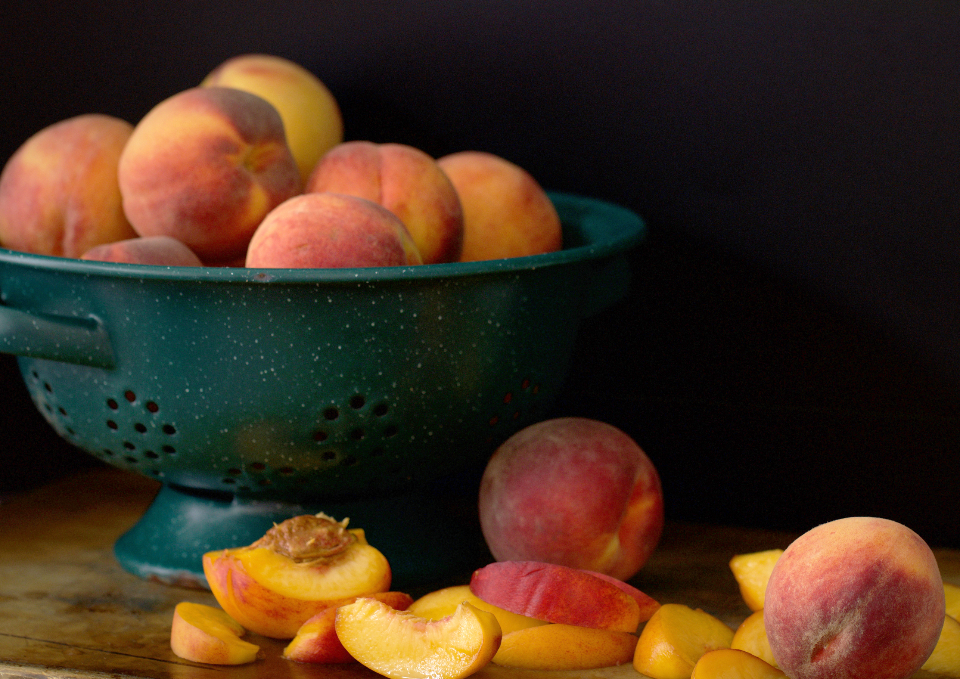 peaches fresh fruit slices organic sweet close up juicy healthy nutrition rustic eating food snack bowl colander