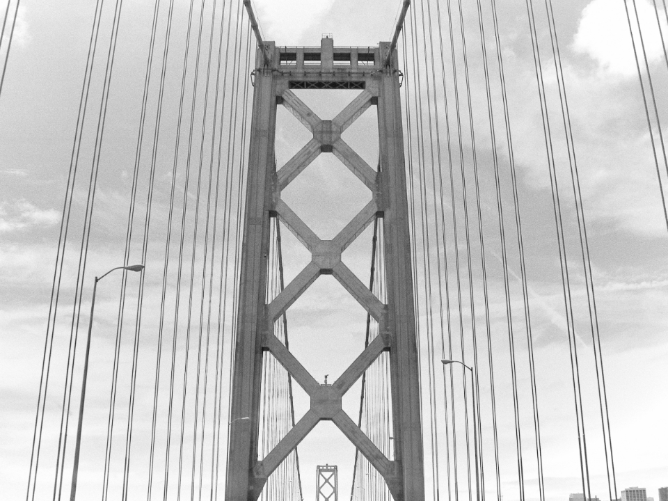 golden gate bridge travel driving monochromatic california abstract coast city road landmark architecture engineering cables san francisco