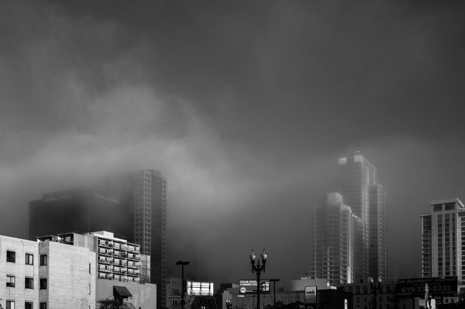 foggy cloudy clouds skyline city black and white architecture