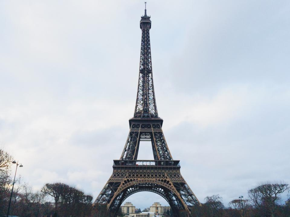 eifle tower france paris trees clouds sky view tourist spots building city urban travel adventure