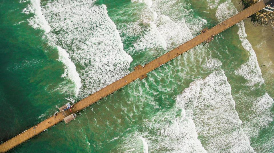 sea ocean water waves nature pier bridge travel outdoor summer vacation beach aerial view