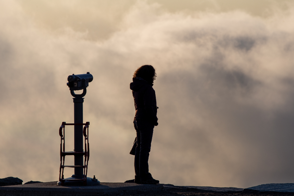silhouette outdoors clouds view sightseeing sunset nature female sky travel person tourist peak mountain