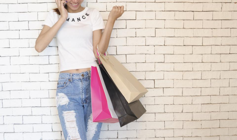 people girl standing talking phone wall shopping bag mall