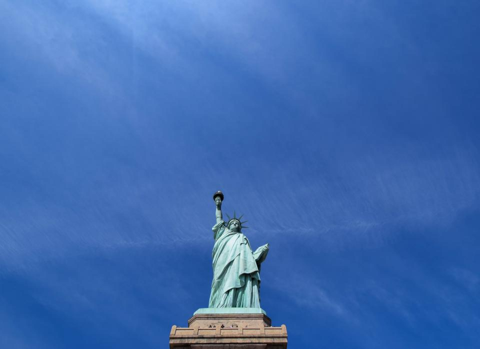 landmark sculpture art statue liberty statue of liberty blue sky
