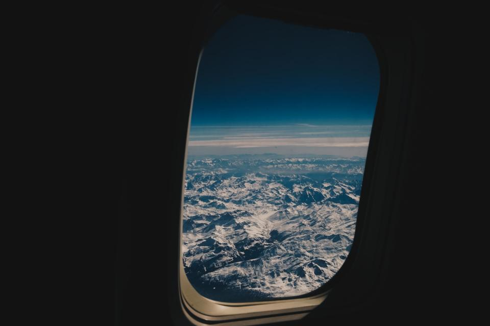 airplane airline travel trip clouds blue sky flight view mountain