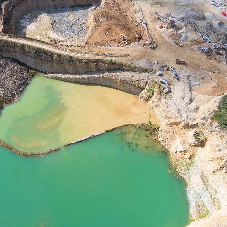 aerial view landscape surface mining rocks mountain water nature truck vehicle