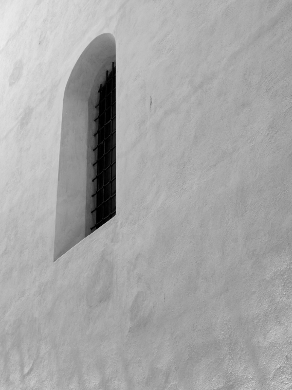 window wall exterior perspective monochromatic architecture design building stone stucco city old