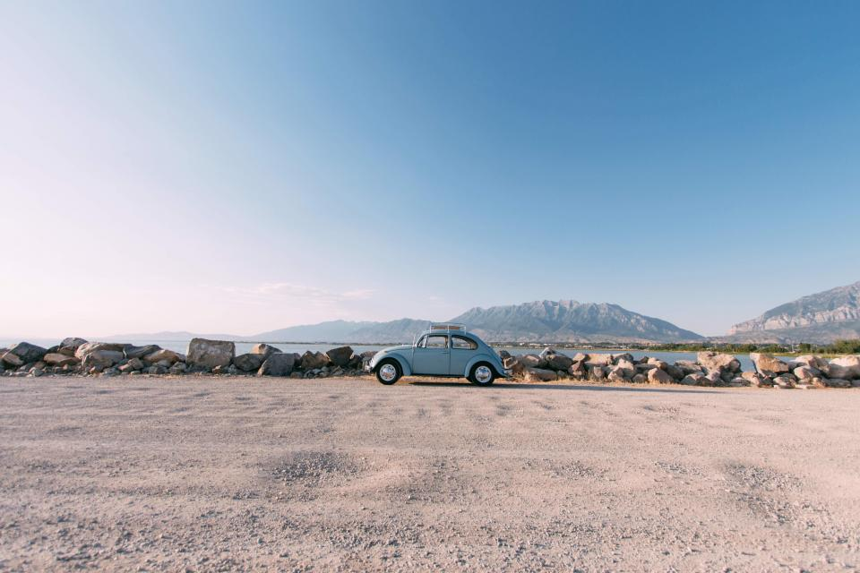 transportation bug volkswagen park rocks stones sand soil ground view nature mountains sky