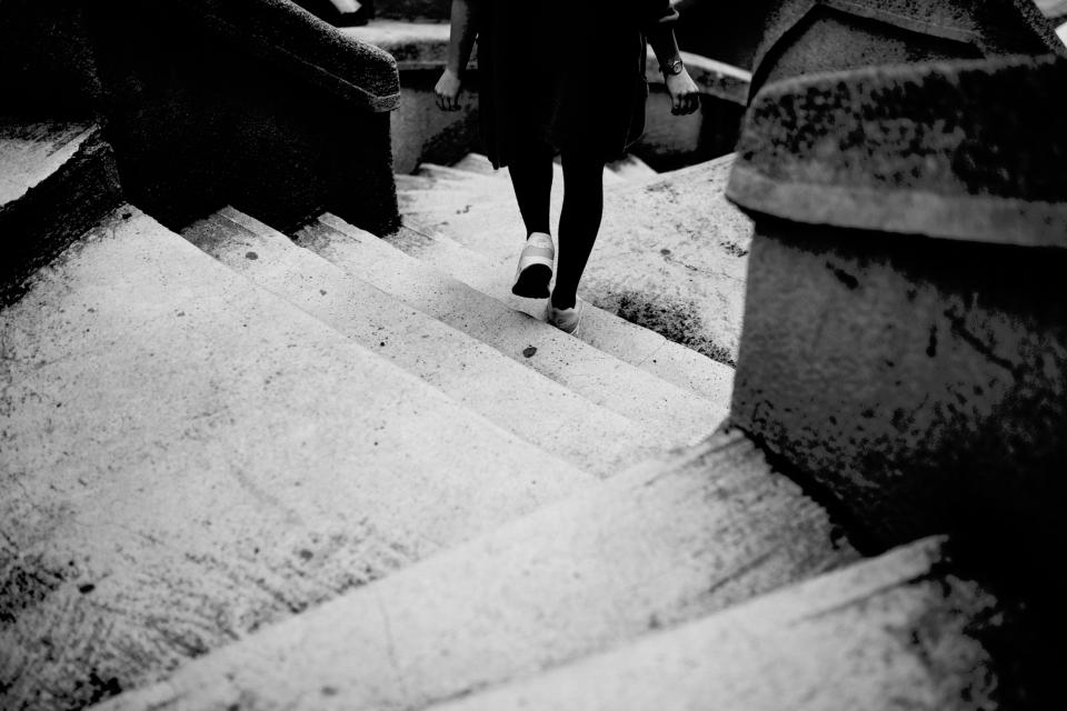 steps stairs people girl lady woman nike air travel black and white grayscale monochrome