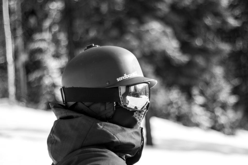 people man helmet gear ski glide snow winter cold weather trees leaves black and white monochrome