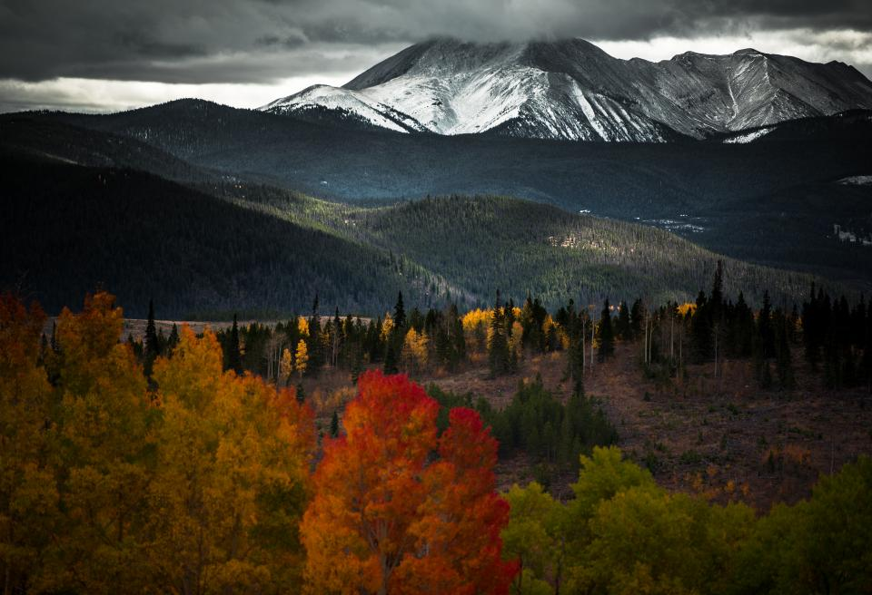 dark sky clouds mountain valley landscape nature plants trees forest autumn fall