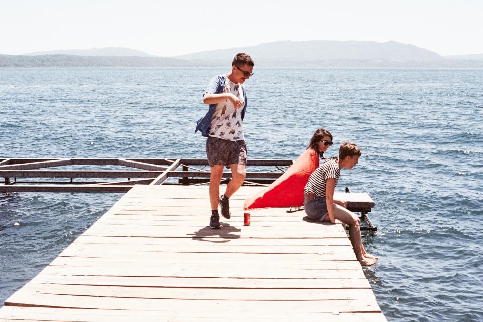 people dock lake water sunshine summer outdoors happy friends group