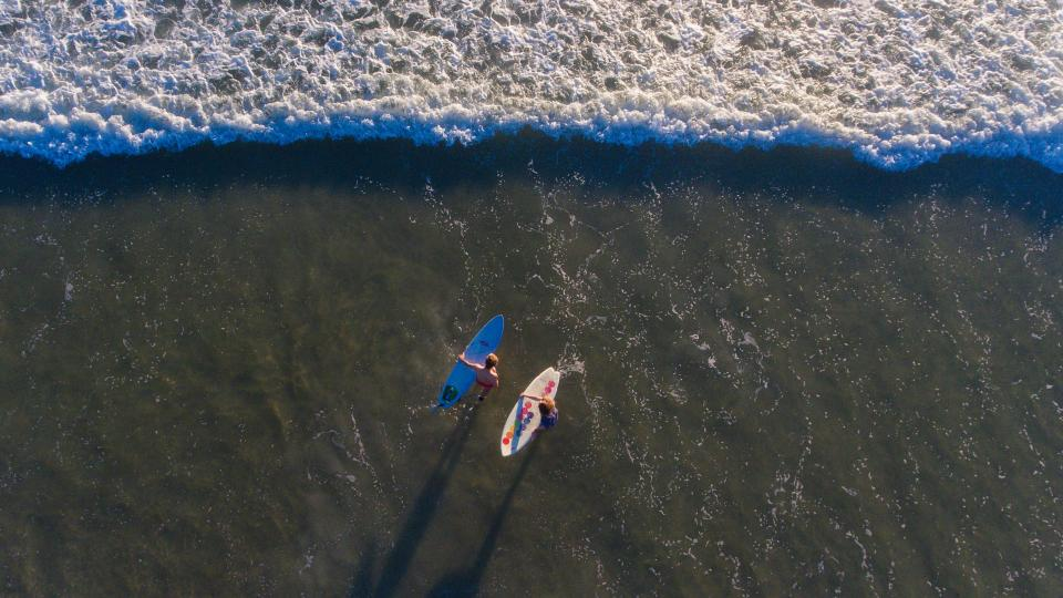 aerial people surf travel adventure ocean sea waves beach sand