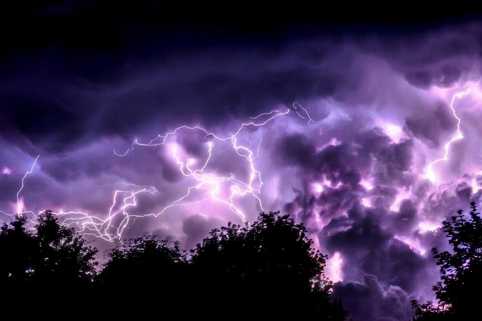 lightning dark night sky clouds tree