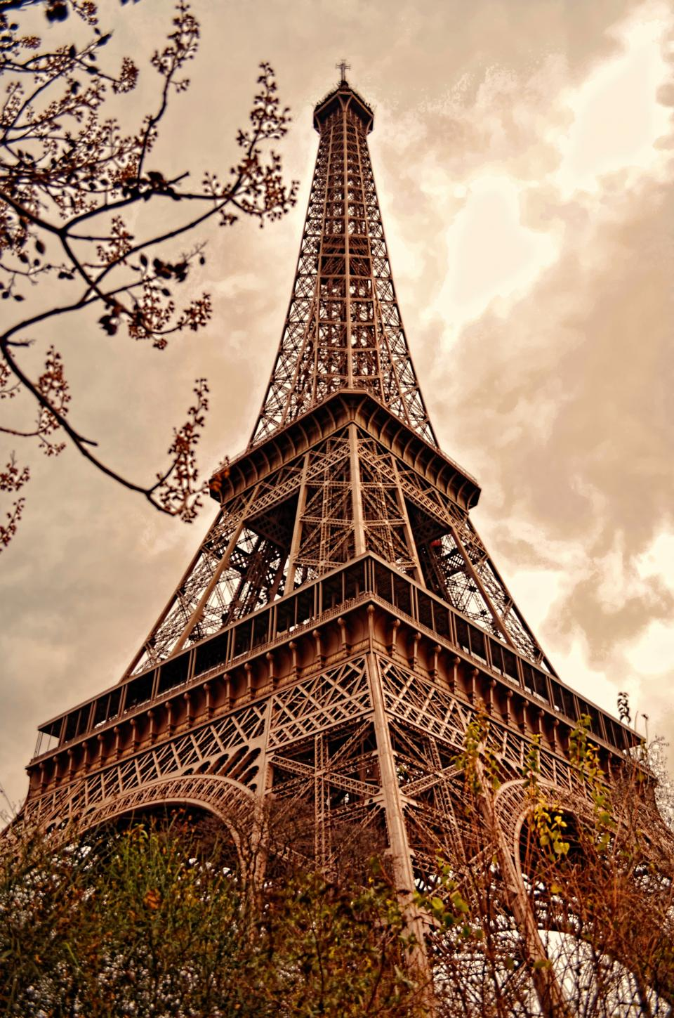 eiffel tower france historic landmark travel skyscraper city clouds sky plants outdoors view