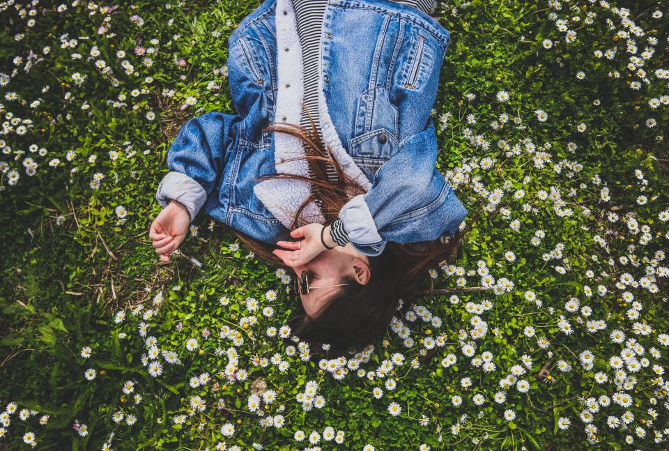 green grass flowers people girl woman rest denim jacket