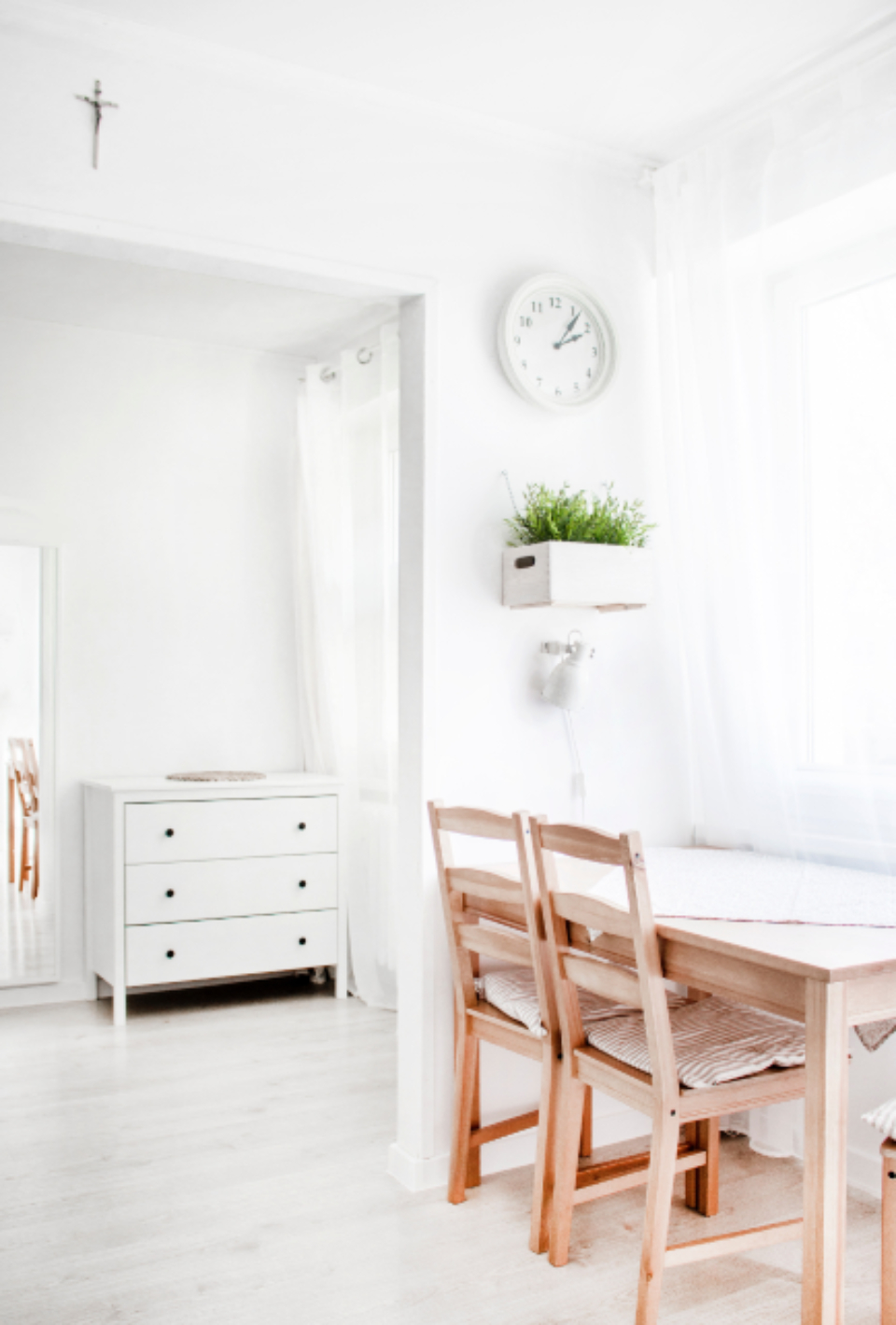 office minimal white chair desk clock drawers plant window