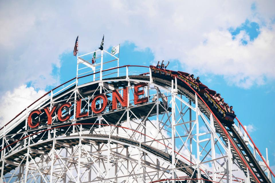 architecture ride amusement park roller coaster clouds sky happy adventure trip
