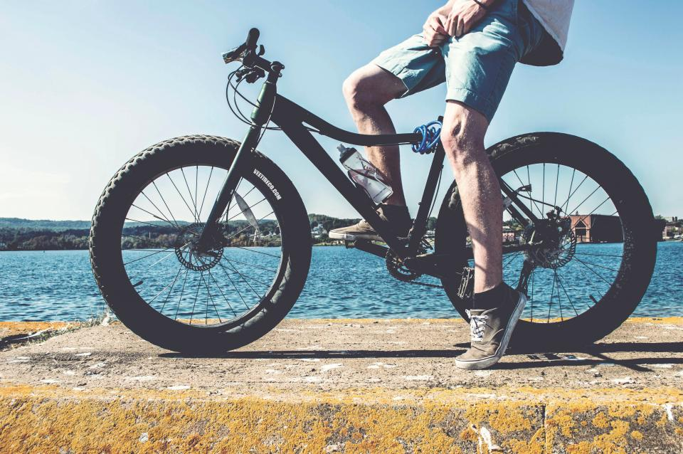 people man bike bicycle water ocean sea beach nature house home hobby exercise sports