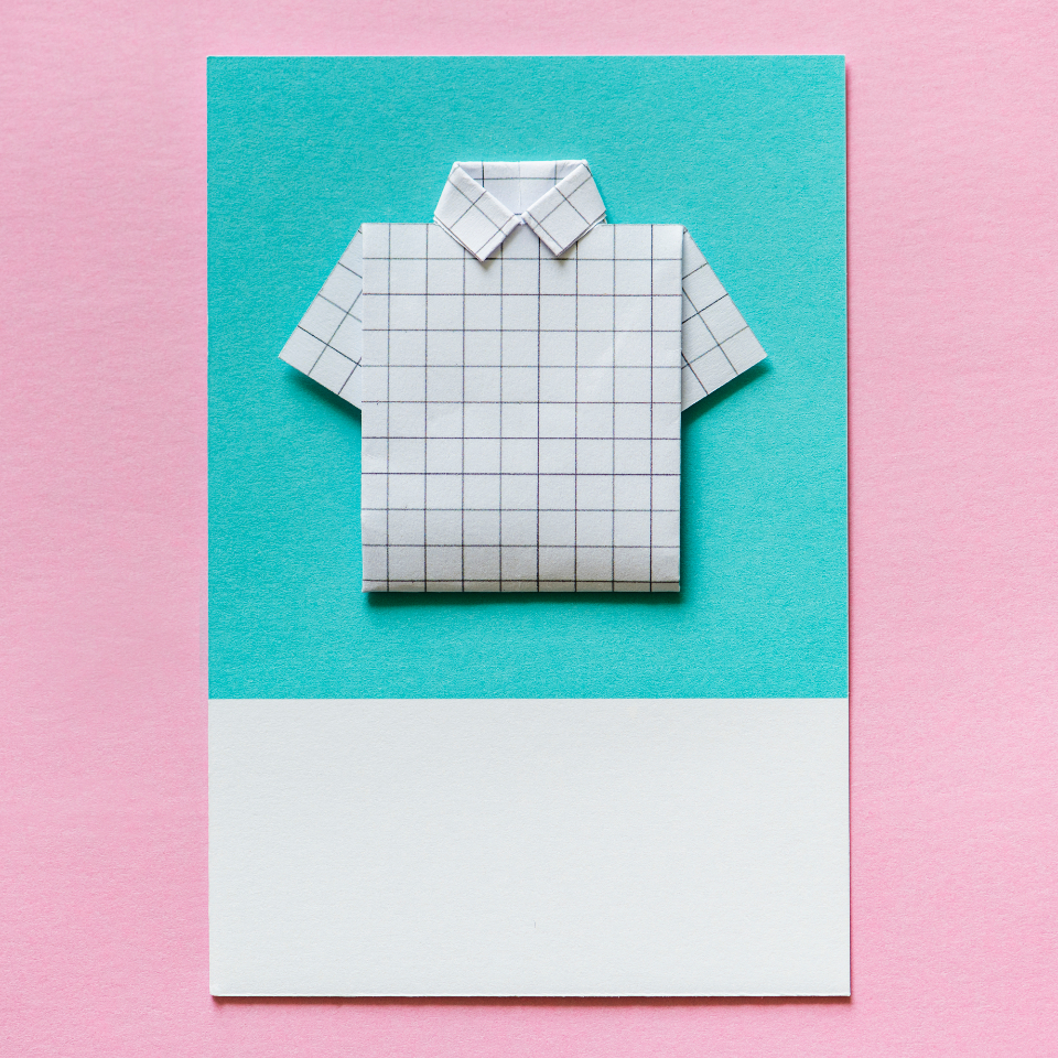 art background blue business card close up clothing colorful creativity decoration design folded handmade isolated lay flat lines micro object origami paper paper craft pink shape shirt top view toy white