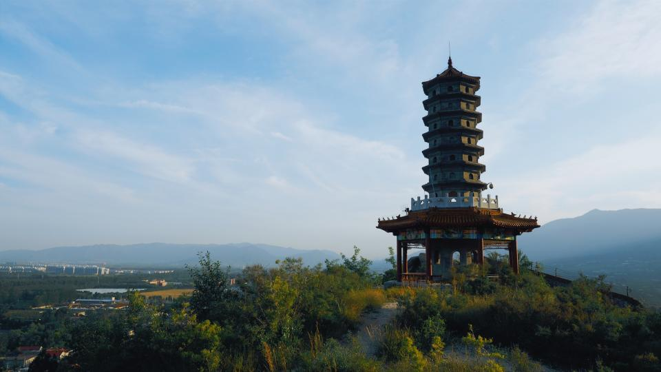 nature architecture structure clouds sky mountains trees pagoda tower