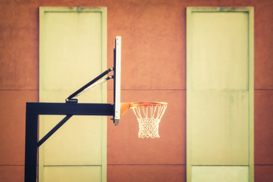 basketball hoop outdoors sports athletics sunny wall building urban warm
