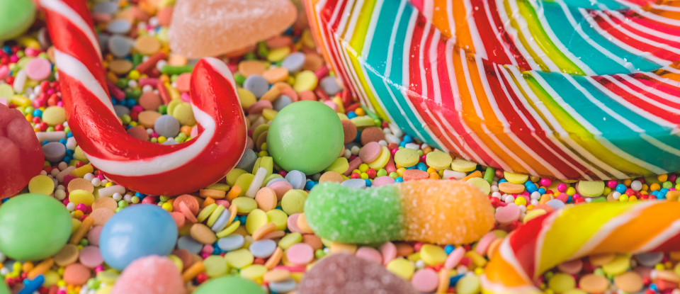 background candy candy cane candycane cane chewy closeup colorful confection confectionery confetti sprinkles delicious dessert edible flavor food gummy jelly lollipop snack stick striped sugar sweets taste tasty texture treat twisted unhealt