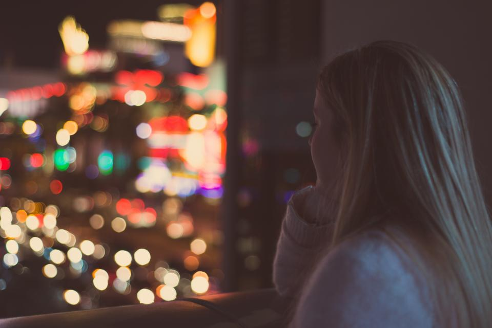 girl woman looking thinking lights blurry abstract bokeh window night evening people