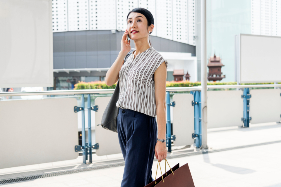 woman walking cellphone call calling communication community connecting connection conversation data device asian digital electronic gadget global information innovation internet media mobile network online phone
