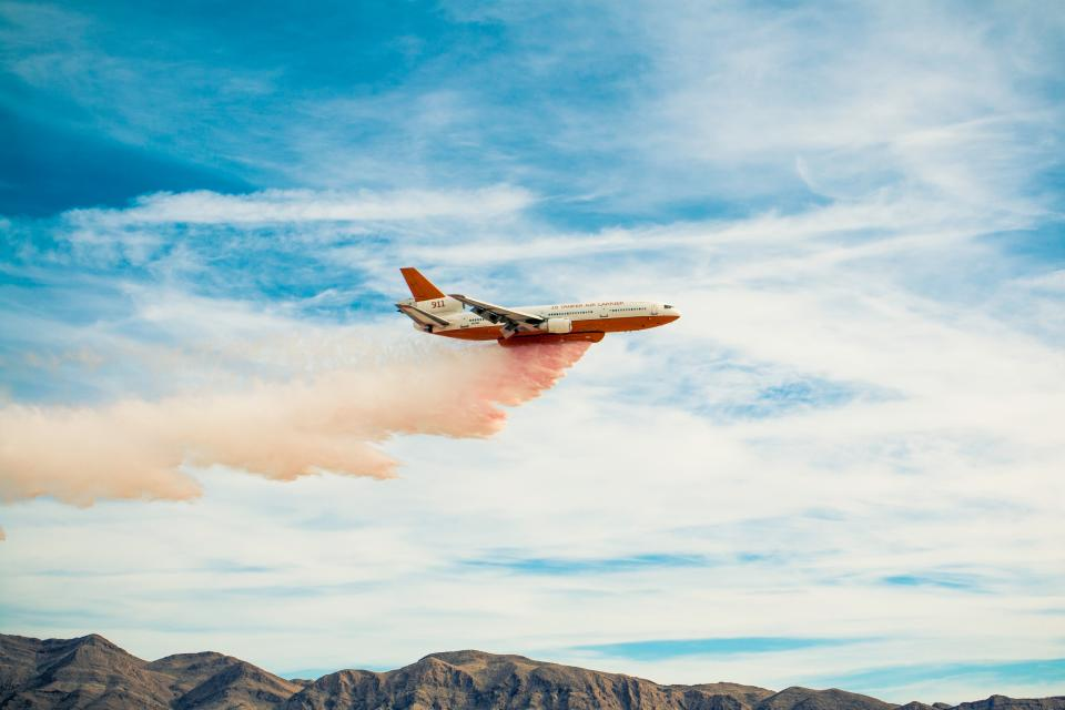 airplane airline travel trip clouds blue sky flight mountain highland view smoke