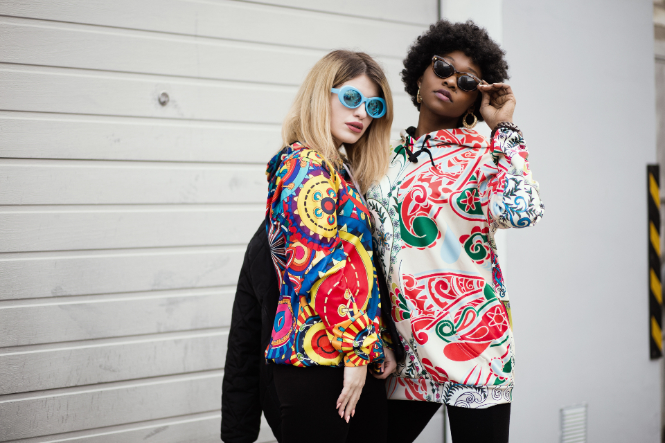 retro woman model sunglasses african american bright shirt wall white female girl