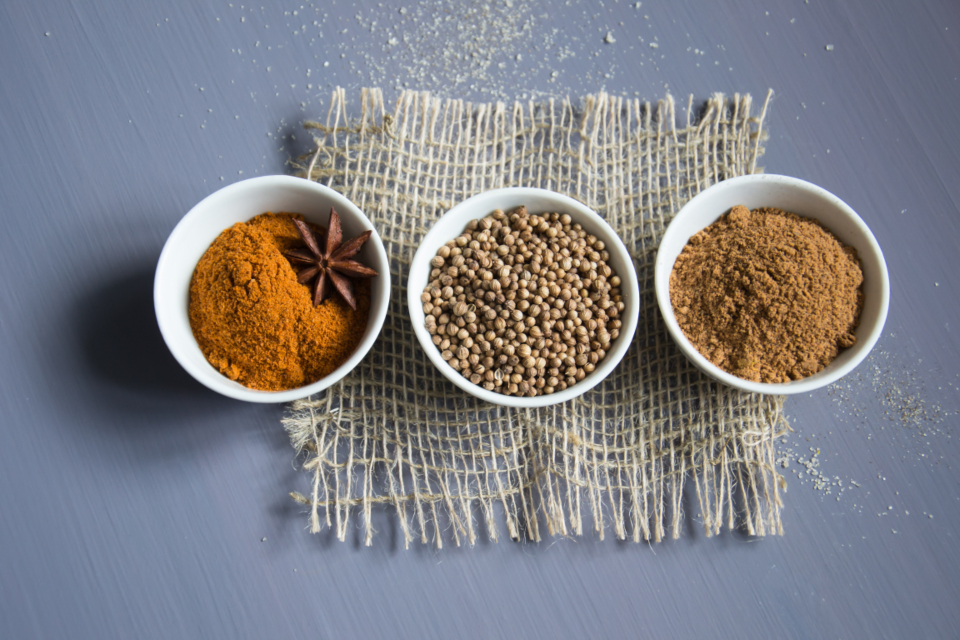 spices ingredients seasoning cuisine food cooking seeds coriander anise paprika nutmeg ceramic cups