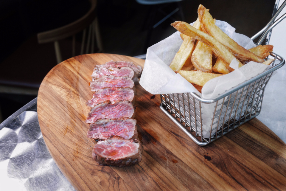 steak fries tenderloin yum beef food chopping board chips