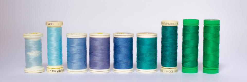 colors crafts sewing thread green purple blue