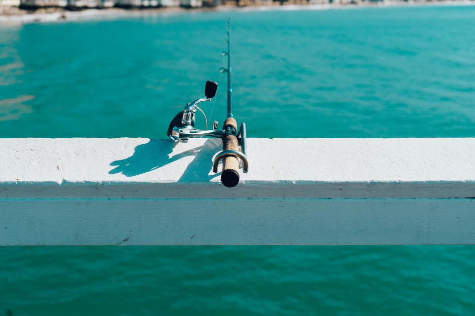 fishing rod pier water ocean sea sunny summer
