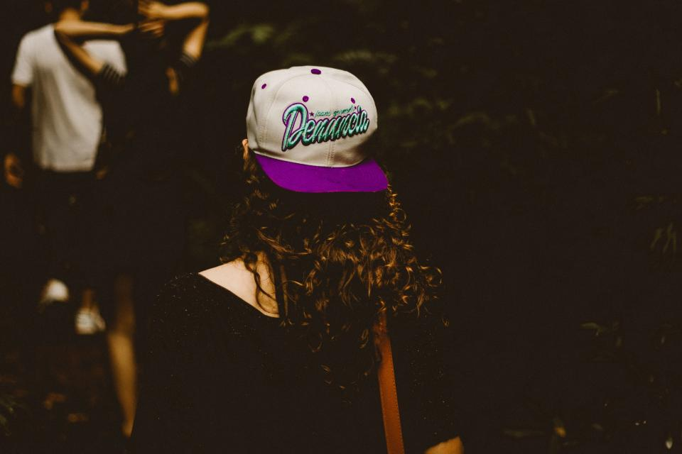 people girl walking blur dark night cap hat back