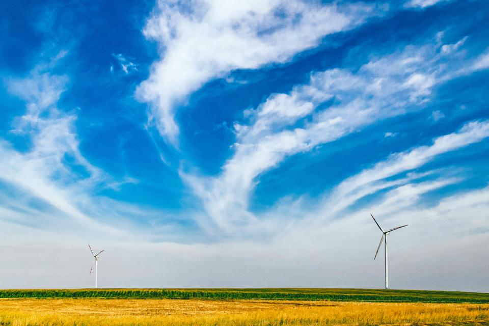 windmills field rural countryside grass plants blue sky clouds nature landscape summer