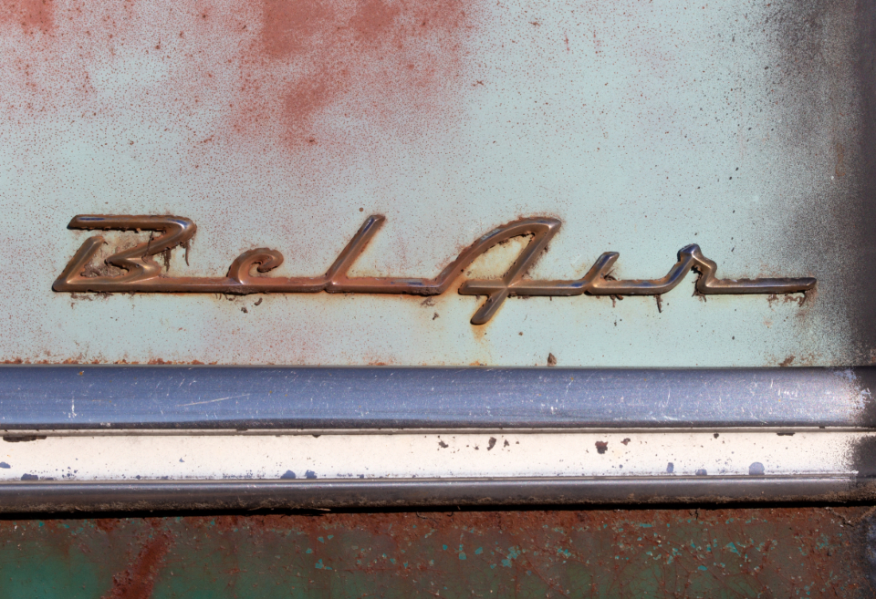 vintage car bel air chevy emblem badge antique classic muscle car hot rod automotive automobile aged weathered worn rust chrome texture surface metal