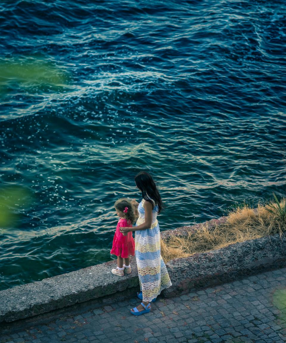 sea ocean water waves nature wall street people kid mother daughter woman child girl