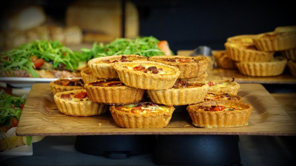 food gourmet eat delicious healthy tarts pies pastries serving tray vegetables still bokeh