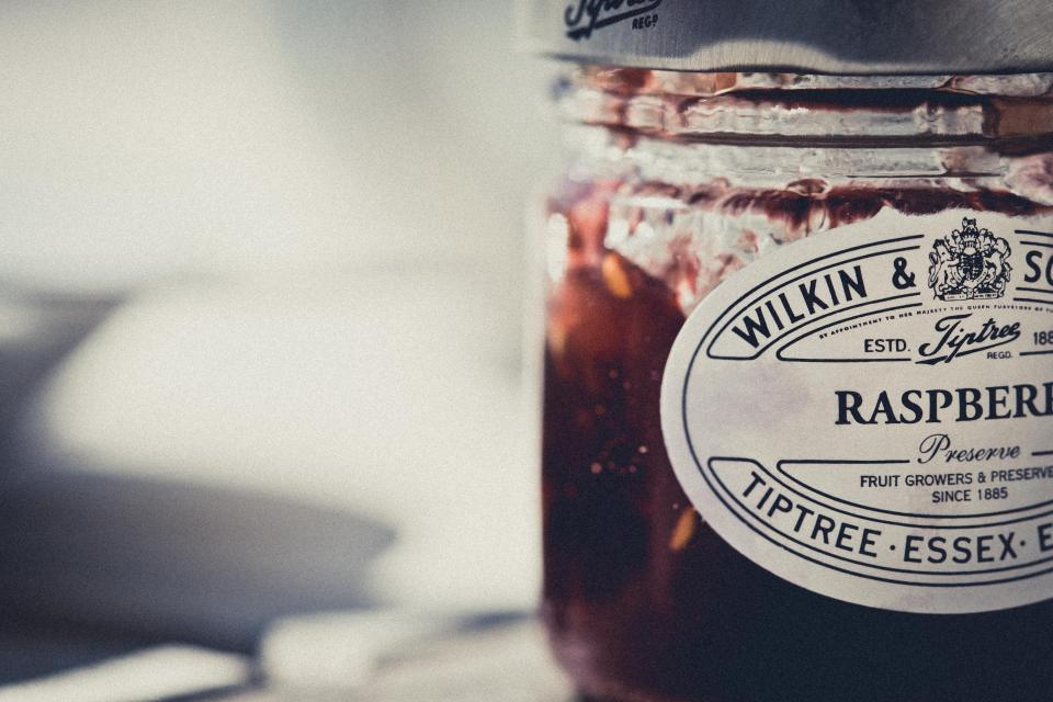 food eat preservatives fruits. raspberries jar still bokeh red delicious