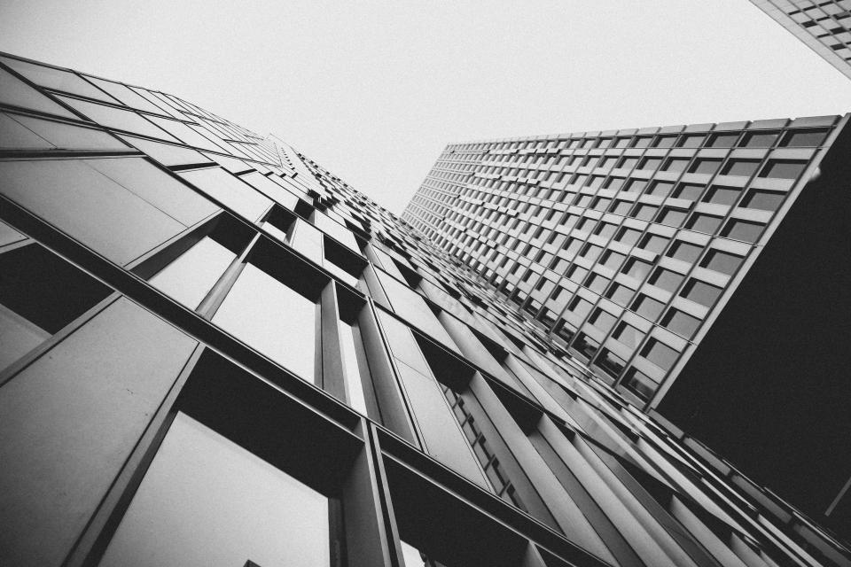 buildings architecture city urban high rises windows business corporate black and white sky