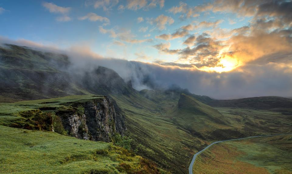 highland mountain hill landscape green grass travel view outdoor nature fog cloud sky road