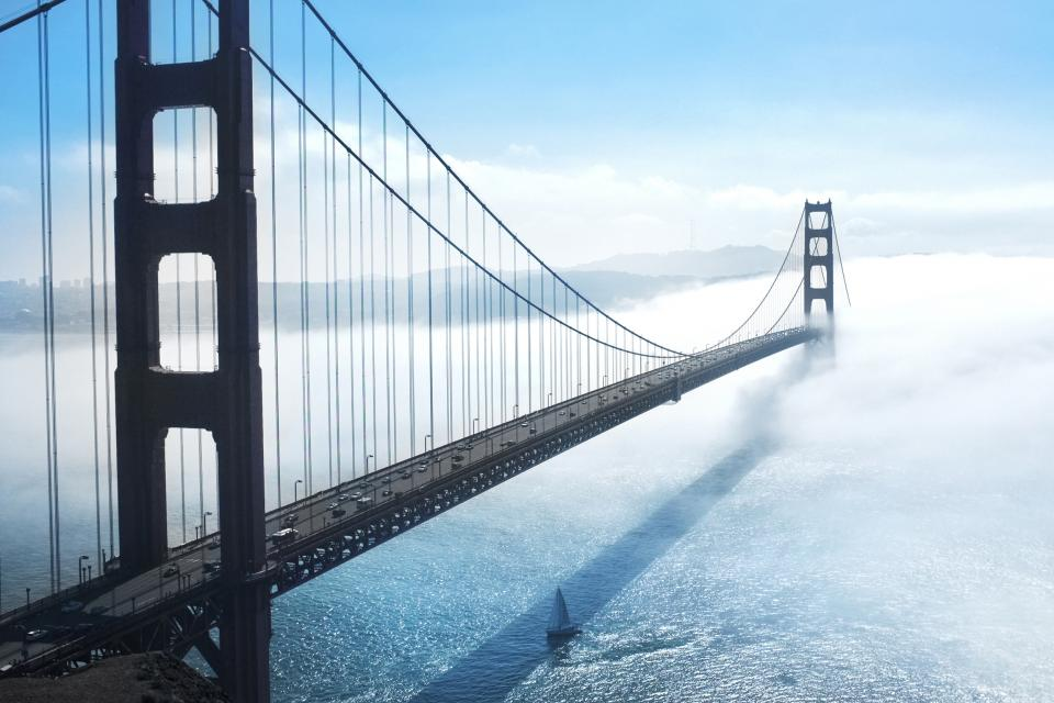Golden Gate Bridge San Francisco bay architecture sea water sailboat sunny fog sky clouds