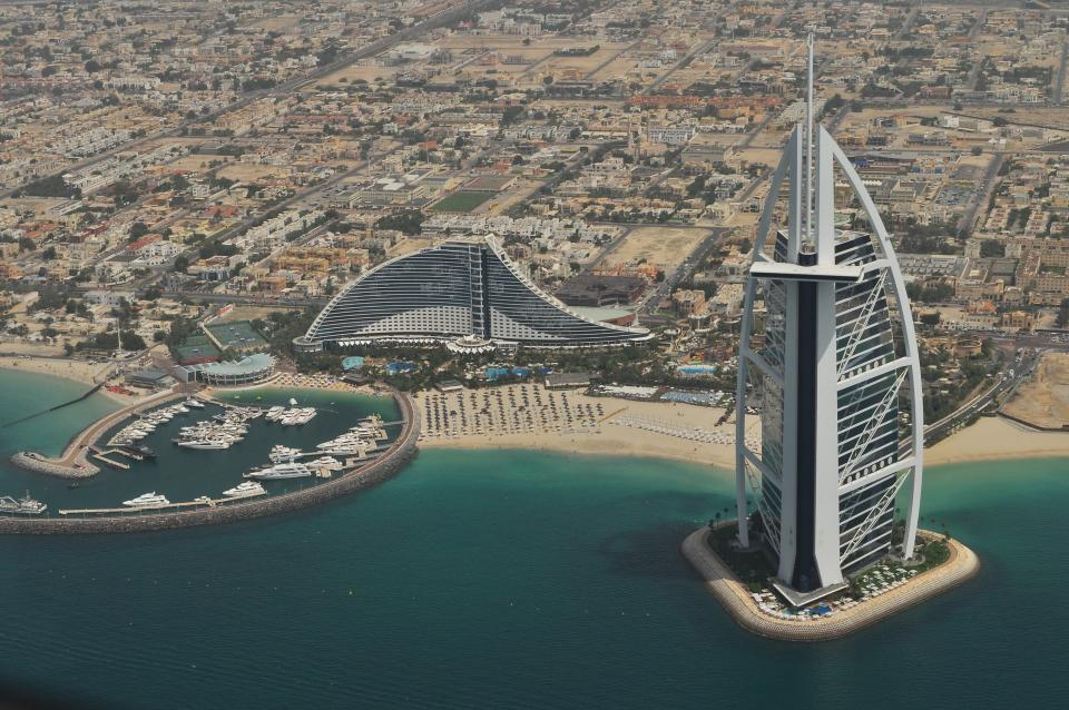 architecture buildings office residential city skyscrapers high rise urban metro burj dubai. desert beach shore water ocean sea