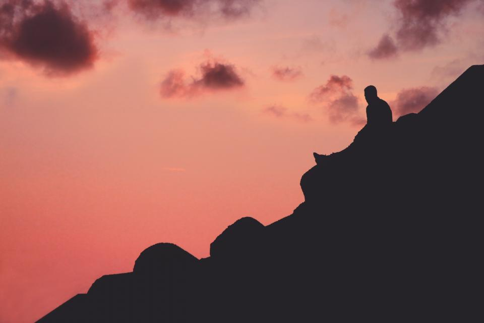 mountain dark sky clouds sunset people sitting alone man silhouette
