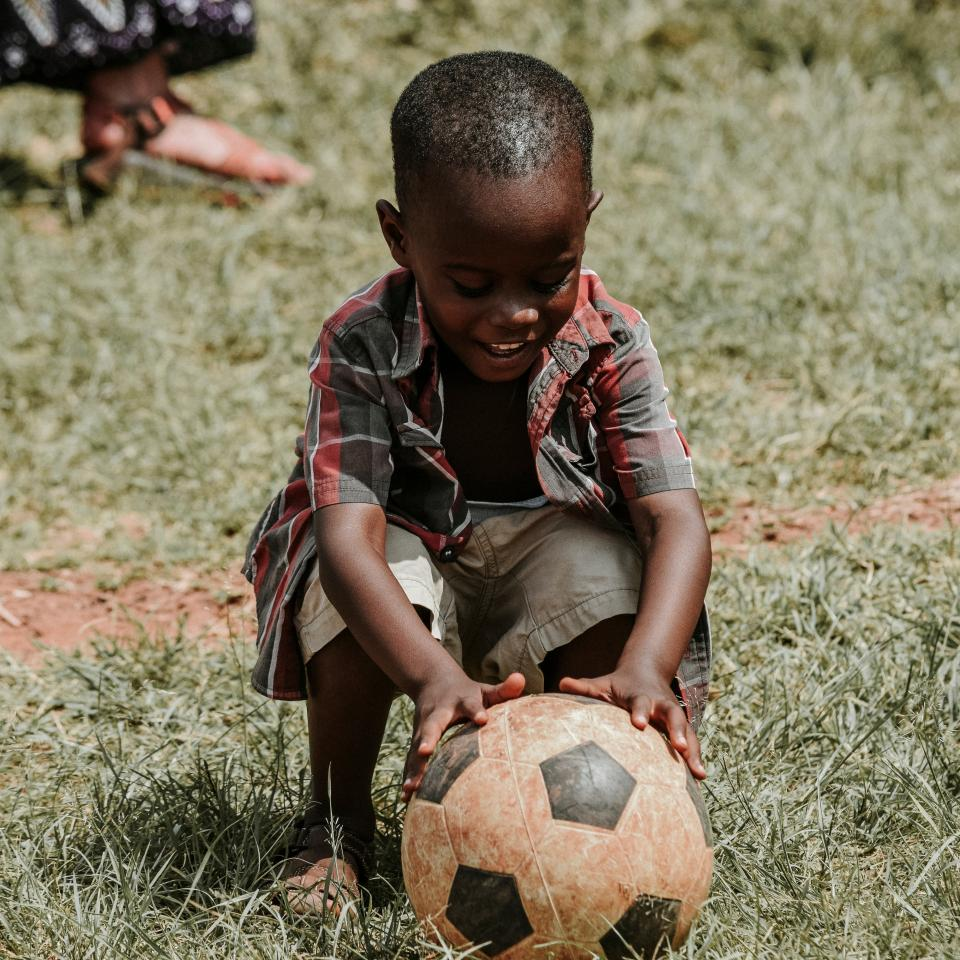boy child kid happy soccer ball grass african american people playing outdoor