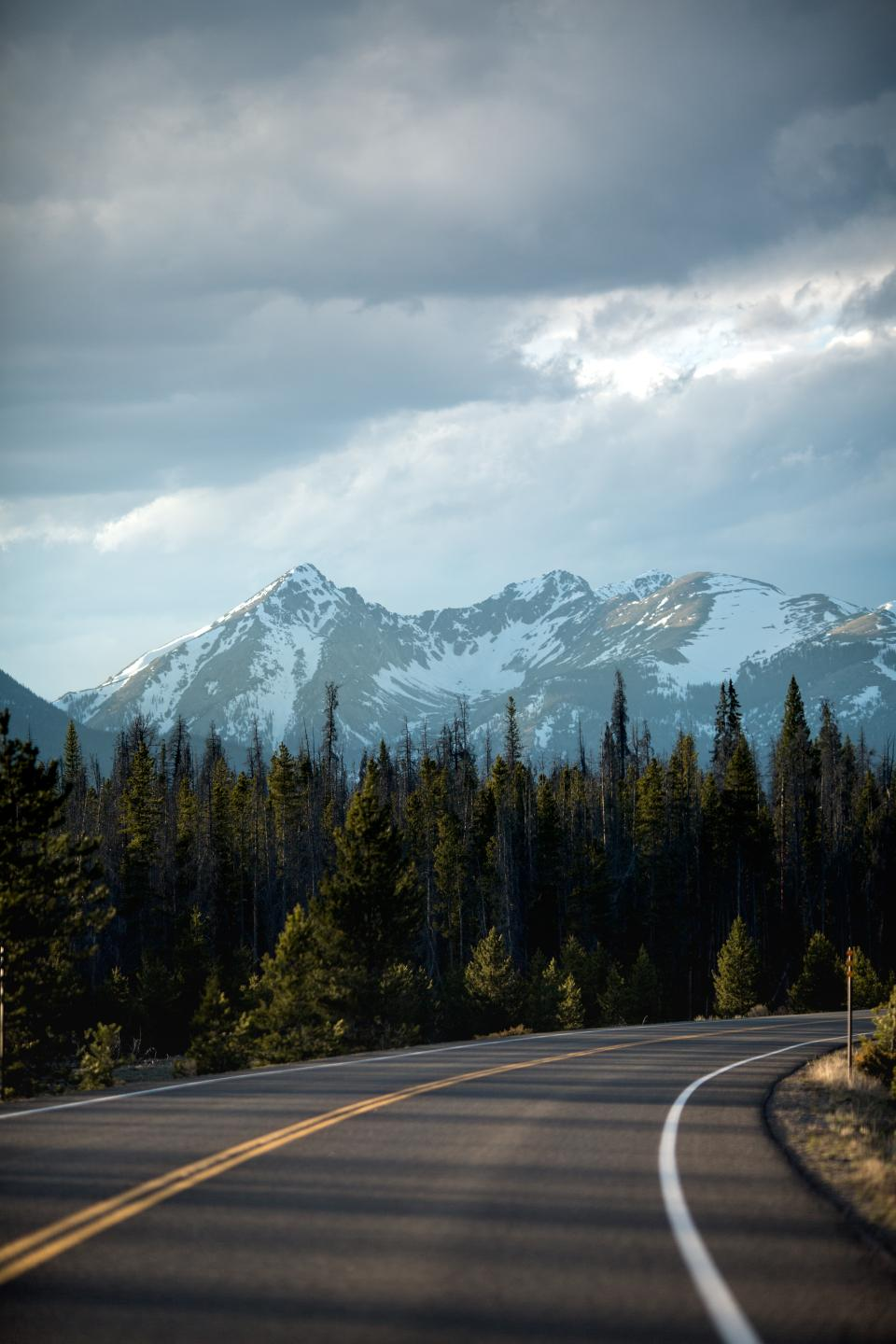 mountain highland cloud sky summit ridge landscape nature valley trees plant road travel outdoor