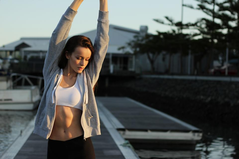girl woman yoga stretch pose health fitness exercise working out beauty people brunette hoodie