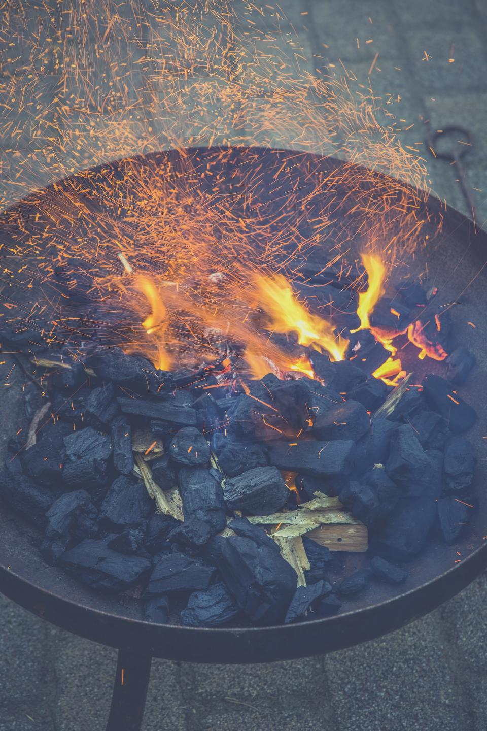 still items things grill charcoal burning flames fire charred sparks light bokeh